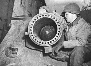 Close-up of projectile in rocket launcher ready for firing with US Private 1st Class, Samuel Belcher of Bluefield, Virginia.