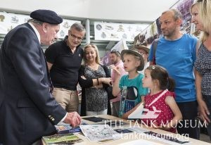 Ernest Slarks meets visitors to the Tank Museum in 2016.