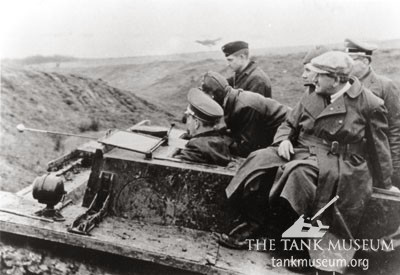 Ferdinand Porsche (in the flat cap) riding the Henschel VK36.01.