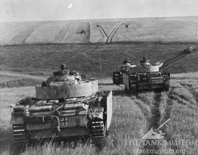 German Panzer IIIs fitted with Schurzen add-on armour on the move.