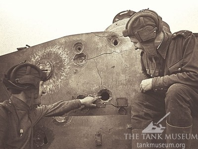 Soviet tankers examine a knocked out Tiger I.