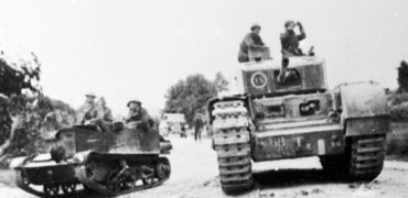 Main- A Churchill Tank and an Infantry Carrier in Tunisia.