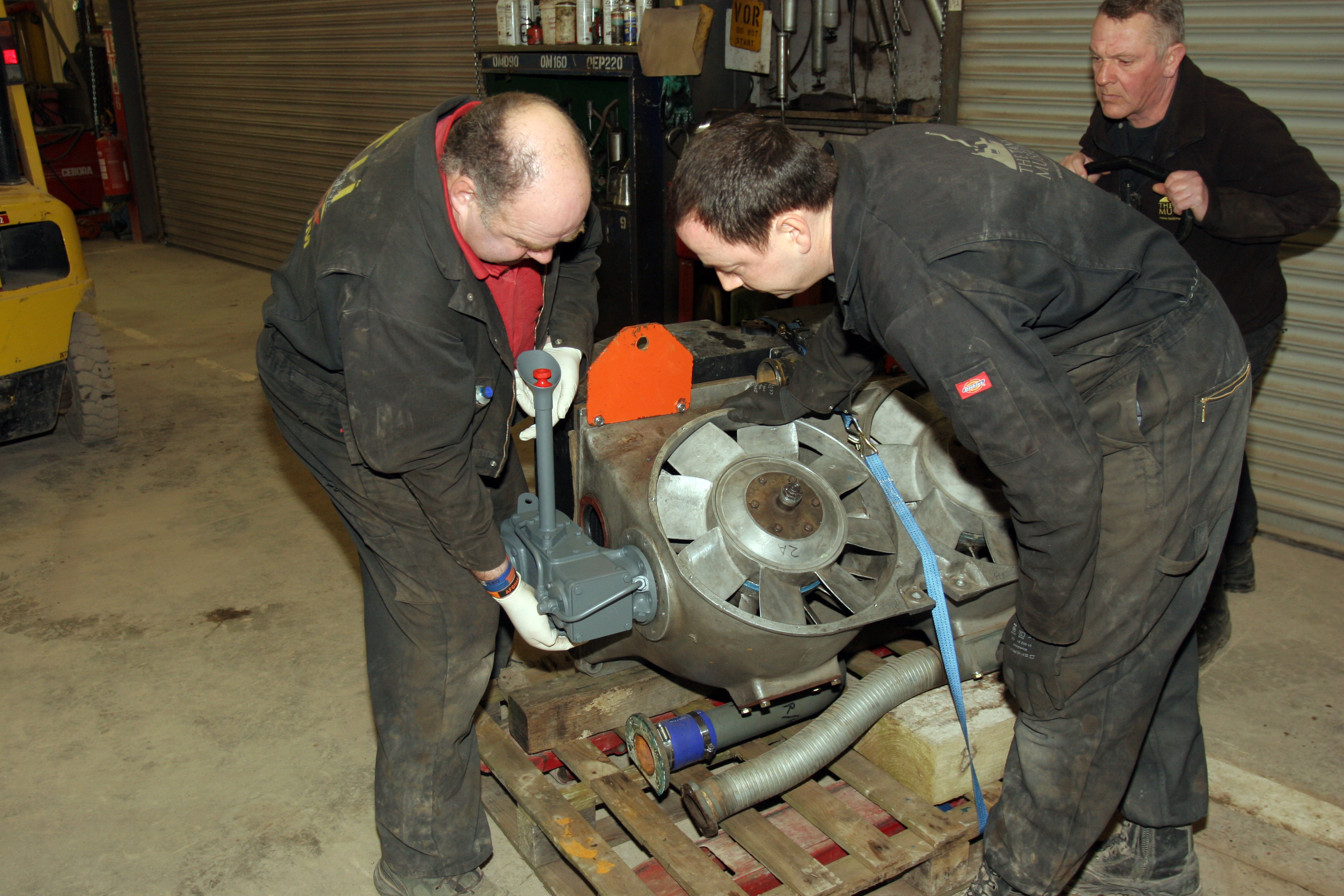 Fitting a gearbox to its fan.