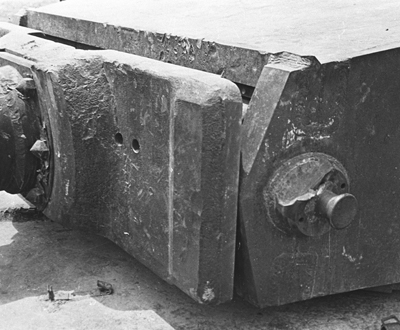 The distinctive damage to the mantlet trunnion.